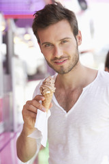 Portrait of a man eating ice cream, Paris, Ile-de-France, France