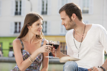 Couple toasting with wineglasses, Paris, Ile-de-France, France