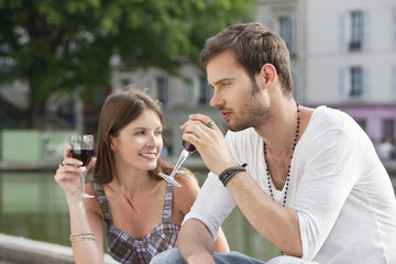 Couple drinking red wine, Paris, Ile-de-France, France