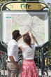 Couple pointing at a map, Paris, Ile-de-France, France