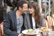 Romantic couple at a restaurant, Paris, Ile-de-France, France