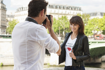 Man taking a picture of a woman with a camera, Seine River, Paris, Ile-de-France, France