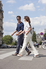 Couple crossing the road, Paris, Ile-de-France, France