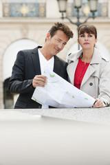 Couple holding a map, Paris, Ile-de-France, France