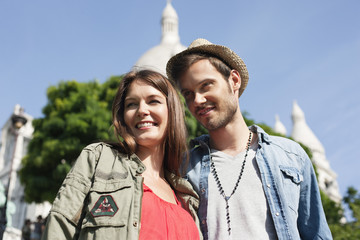 Low angle view of a couple smiling, Montmartre, Paris, Ile-de-France, France