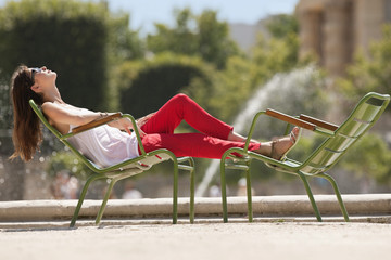 Woman resting in a chair near a pond, Bassin octogonal, Jardin des Tuileries, Paris, Ile-de-France, France