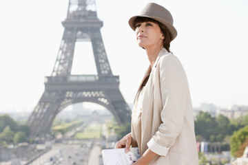 Profile of a woman with the Eiffel Tower in the background, Paris, Ile-de-France, France