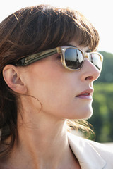 Close-up of a woman wearing sunglasses, Paris, Ile-de-France, France