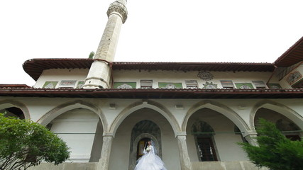bride comes out of  mosque after Islamic wedding ceremony