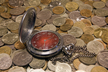 Pocket watch against Russian coins.
