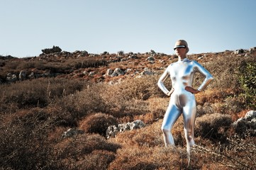 Cyber woman in a mountains.