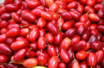 Fresh Cornelian cherries background