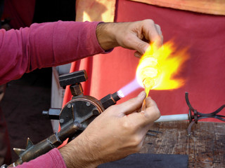 hands of the handicraftsman making a glass subject at fair of cr