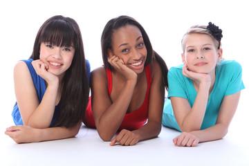 Black white and asian girl friends lying on floor