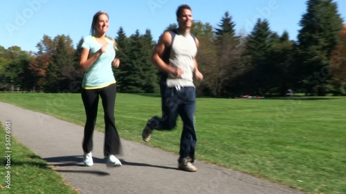 Jogging happy couple. Sport and fitness.