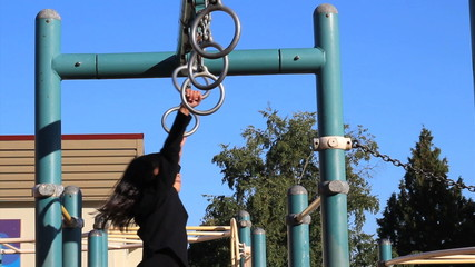 Asian Girl Using Old Style Playground Rings