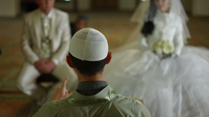 imam preaching in mosque during wedding ceremony