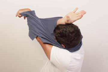 Man stuck inside of his shirt