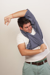 Man tangled in his shirt