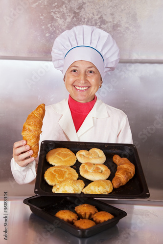 Baker with  pastries