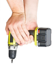 battery screwdriver in hand