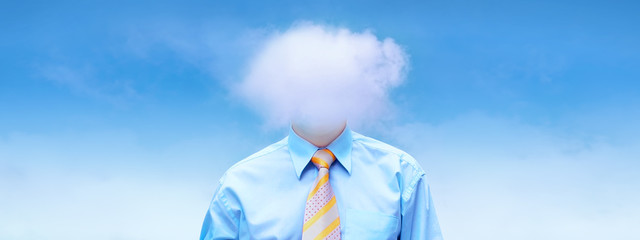 Hasppiness businessman under blue sky with clouds