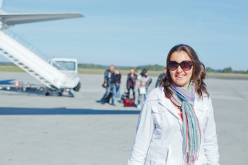 beautiful woman tourist prepared to fly
