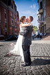 young bride  jumping on groom and kissing him