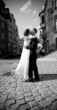 Black and white photo ofnewly married couple kiss