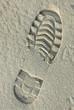 Schuhabdruck im Sand 190