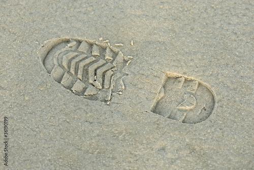 Schuhabdruck im Sand 197