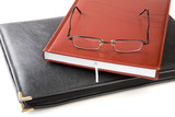 Folder for papers an organizer and glasses isolated