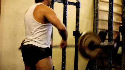 Person raises a barbell