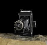nostalgic camera on stone surface poster