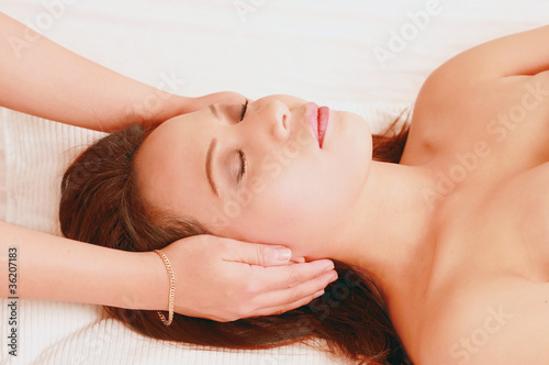 Young woman in reiki healing session