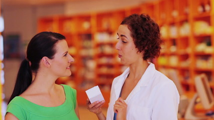 Pharmacist explaining medicine in pharmacy