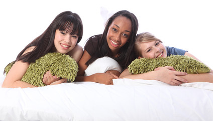 Mixed race teenage girl friends at slumber party