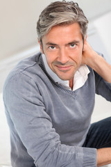 Handsome man relaxing in sofa at home