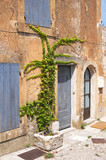 Entry to old tenement house in Gordes, Provence in France poster