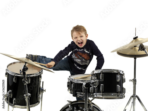 young boy play drum with energy
