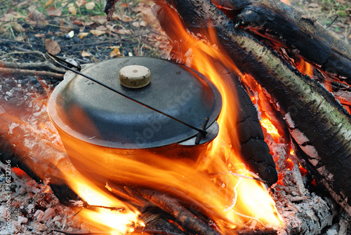 camping fire and food in pot