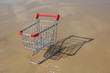 Retail cart stuck in the sand, methaphor for business challenge