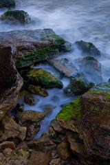 Rocky sea shore at the dusk