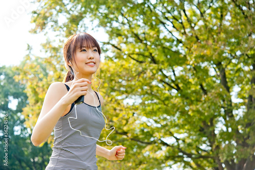 beautiful asian runnning in the park