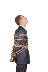 businessman executive tied up with rope, looking up