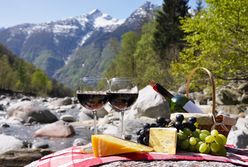 Red wine, cheese and grapes.Verzasca valley, Switzerland