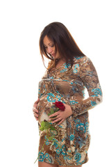 Beautiful pregnant woman with flower