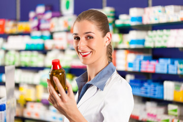 Female pharmacist in her pharmacy