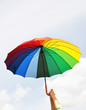 Rainbow umbrella in the hands