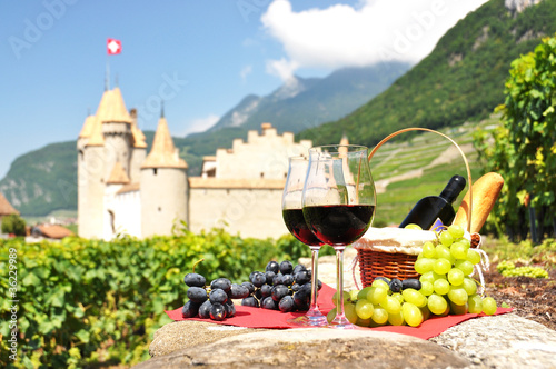 Red wine and grapes against an old castle. Switzerland © HappyAlex